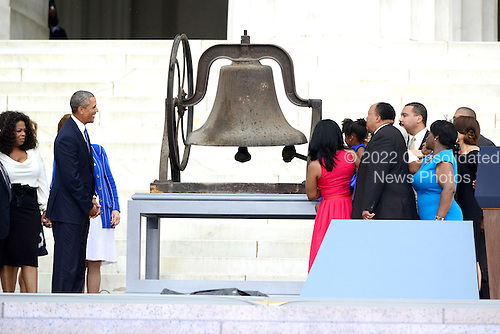 United States President Barack Obama looks on as a bell is rung at the Let Freedom Ring ceremony on the steps of the Lincoln Memorial to commemorate the 50th Anniversary of the March on Washington for Jobs and Freedom<br /> Credit: Ron Sachs / CNP