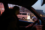 A Beijing driver in a traffic jam during rush hour.