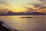 Outrigger canoe at sunset, Tahiti with Moorea in background<br />
