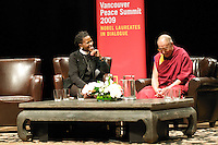 His holiness, the Dalai Lama, right, and Mpho Andrea Tutu, daughter of Archbishop Desmond Tutu, during the 'World peace through personal peace' panel discussion, at the Chan Center for the Performing Arts, Sept. 27, 2009, at the University of British Columbia campus in Vancouver BC. (Scott Alexander/pressphotointl.com)