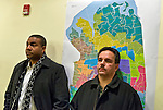 January 3, 2013 - Mineola, New York, U.S. -  At right, PATRICK NICOLASI of Elmont, NY, stands in front of the Republican Commissioners' Proposed map, which did not include street names, on the back wall of Nassau County Legislature Chambers. The Nassau County Districting Advisory Commission held a night time meeting on two Redistricting maps for the 19 Legislative Districts, one proposed by Republicans, one by Democrats. In the standing room only chambers, dozens shared their views with the commission during the Public Comment segment. After a brief recess, the commission voted at 10:40 PM for each map, neither of which passed. By January 5 it must complete its work for the Nassau Legislature, which must pass a Redistricting map by March 5, 2013.