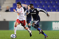 Sinisa Ubiparipovic (8) of the New York Red Bulls is chased by Joseph Niouky (23) of the New England Revolution. The New York Red Bulls defeated the New England Revolution 3-0 during a U. S. Open Cup qualifier round match at Red Bull Arena in Harrison, NJ, on May 12, 2010.