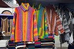 Colorful woven jackets on display in Otavalo marketplace in Ecuador
