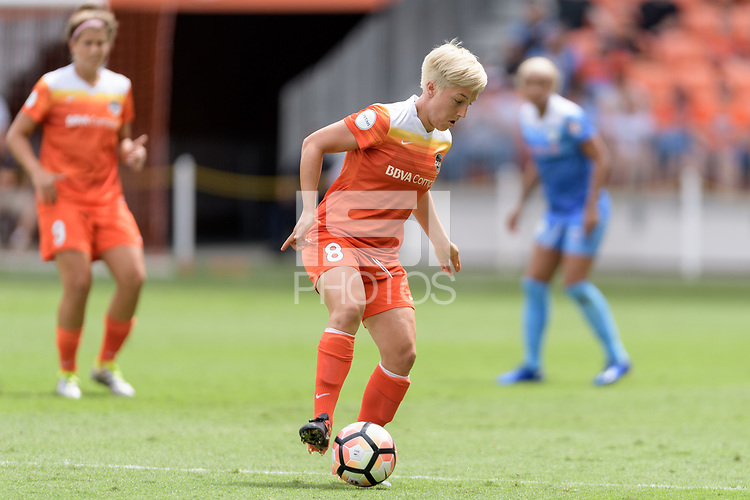 Houston, TX - Saturday April 15, 2017: Claire Falknor attempts to pass the ball during a regular season National Women's Soccer League (NWSL) match won by the Houston Dash 2-0 over the Chicago Red Stars at BBVA Compass Stadium.