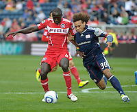 Chicago forward Dominic Oduro (8) is pressured by New England defender Kevin Alston (30).  The Chicago Fire defeated the New England Revolution 3-2 at Toyota Park in Bridgeview, IL on Sept. 25, 2011.