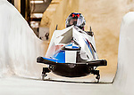 8 January 2016: USA pilot Steven Holcomb threads the needle down the Chicane during his second run of the 2-man bobsled, taking the gold medal with his brakeman Carlo Valdes, closing out the day of racing at the BMW IBSF World Cup Championships at the Olympic Sports Track in Lake Placid, New York, USA. Mandatory Credit: Ed Wolfstein Photo *** RAW (NEF) Image File Available ***