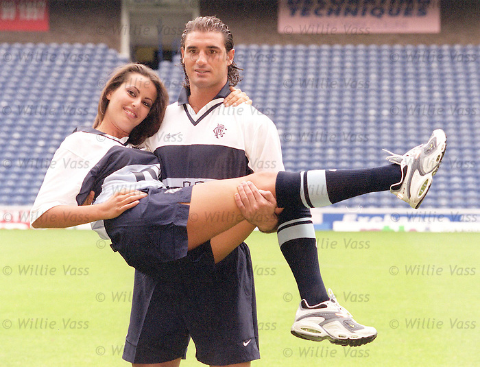 Lorenzo Amoruso with 25 year old girlfriend and model Cristina Massatti as Rangers show their new away stips in July 2000