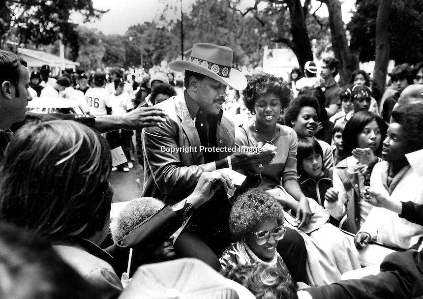Hometown hero Pittsburg Pirate great Willie Stargell surrounded by fans at a parade in Alameda, Ca.where grew up and when attended high school..(1980 photo by Ron Riesterer)