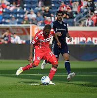 Chicago forward Patrick Nyarko (14) shoots into an empty net and scores as New England defender Franco Coria (2) looks on.  The Chicago Fire defeated the New England Revolution 3-2 at Toyota Park in Bridgeview, IL on Sept. 25, 2011.