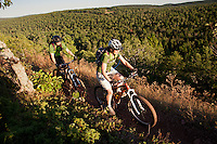 A couple rides the On the Edge mountain bike trail along Brockway Mountain in Copper Harbor Michigan.