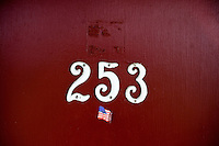 An American flag sticker hangs on the door of room 253 at Motel Caswell in Tewksbury, Massachusetts, USA, on Tuesday, Oct. 11, 2011. The motel is owned by Russell Caswell. Caswell's father built the motel in the 1950s. Now, conservative activitists are trying to use federal asset-forfeiture laws to seize the motel, saying that the motel is used by drug dealers to conduct business.  The legal challenge intends to show evidence tying the property to crimes in order to seize the motel.....CREDIT: M. Scott Brauer for the Wall Street Journal.slug: FORFEIT