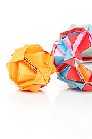 New York, NY, USA - November 4, 2011: Two Ishibashi balls designed by Japanese Origami artist Minako Ishibashi. Each piece is folded from multiple pieces of colored paper by Esme Cribb.