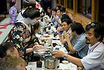 "Customers enjoy dinner aboard a ""Yakata-bune"" pleasure boat run by the Yasuda family in Tokyo, Japan on 31 August  2010. .Photographer: Robert Gilhooly"
