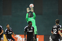 Washington, D.C.- July 20, 2014. Bill Hamid (28) of D.C. United goes up to make a save.  D.C. United defeated Chivas USA 3-1 during a Major League Soccer Match for the 2014 season at RFK Stadium.