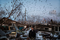 56 year old migrant worker Ergebai Kosybayeb, who moved to Astana to set up a mechanics shop and currently lives in a delapidated former summer house. <br /> <br /> There are many crumbling summer houses dotted around the city, a throwback to a time when the residents maintained vegetable gardens during the warmer summer months. Today they house migrants, usually working in construction, who cannot afford other accommodation.