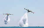 Water Bombers CL-415 firefighting amphibious aircrafts releasing water at Canadian International Air Show in Toronto