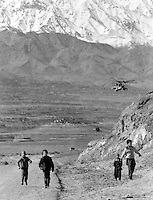 "Soviet Mi-24 ""Hind"" attack helicopters escort a fuel convoy on its way to the Afghan capital Kabul on Sunday, February 5, 1989. Under siege for several years, the regime in Kabul depends heavily on Soviet military support."