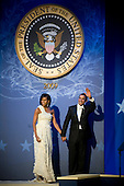 Washington, DC - January 20, 2009 -- United States President Barack Obama and first lady Michelle Obama wave to audience after dancing at the Commander-in-Chiefs Ball at the National Building Museum, Washington, D.C., Tuesday, January 20, 2009. The ball honored Americas service members, families the fallen and wounded warriors. .Credit: Chad J. McNeeley - DoD via CNP