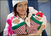 BNPS.co.uk (01202 558833)<br /> Pic: CorinMesser/BNPS<br /> <br /> Twins Jasmine(r) and Amber with mum Kat.<br /> <br /> Twin baby girls who have beaten the odds to survive after being born three months premature have been reunited in time for Christmas.<br /> <br /> Little Jasmine and Amber Smith-Leach were born 12 weeks early, weighing just 2lb 2oz and 2lb 12oz respectively. <br /> <br /> Despite not being due until January 22, the babies have fought through setback after setback.<br /> <br /> Last night (sat) the pair shared a cot for the first time while mum Kat Smith slept next do them.