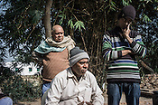 53 year old, Badrinath Singh, (right) father of the rape victim speaks while his younger son, Gaurav (in cap) stands next to him during an interview in his ancestral house in Medawar Kalan in Ballia district of Uttar Pradesh, India.