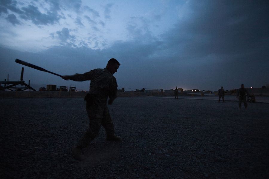 "A relaxing game of whiffle ball on a quiet evening. Scenes from the medical evacuations of wounded Americans, Canadians, and Afghan civilians and soldiers being flown by Charlie Co. 6th Battalion 101st Aviation Regiment of the 101st Airborne Division. Charlie Co. - which flies under the call-sign ""Shadow Dustoff"" - flies into rush the wounded to medical care out of bases scattered across Oruzgan, Kandahar, and Helmand Provinces in the Afghan south. These images were taken of missions flown out of Kandahar Airfield in Kandahar Province and Camp Dwyer in Helmand Province."
