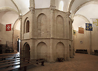 Barrell-vaulted ambulatory with twelve sections, separated by arches, Iglesia Vera Cruz (Church of the True Cross), 13th century, Road to Zamarramala, Segovia, Castile and Leon, Spain. Constructed by the Knights Templar to house a fragment of the True Cross, consecrated, 1208. Romanesque 12-sided polygonal building broken to the east by the triple apse and to the south by the tower. Picture by Manuel Cohen