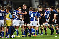 The teams shake hands after the match. Rugby World Cup Pool C match between New Zealand and Namibia on September 24, 2015 at The Stadium, Queen Elizabeth Olympic Park in London, England. Photo by: Patrick Khachfe / Onside Images