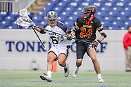 Annapolis, MD - February 11, 2017: Navy Midshipmen Greyson Torain (6) fights off Maryland Terrapins Nick Brozowski (24) during game between Maryland vs Navy at  Navy-Marine Corps Memorial Stadium in Annapolis, MD.   (Photo by Elliott Brown/Media Images International)