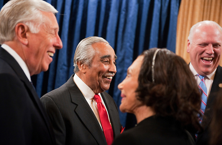 UNITED STATES - SEPTEMBER 22:  From left, House Minority Whip Steny Hoyer, D-Md., Rep. Charlie Rangel, D-N.Y., his wife Alma, and Rep. Joe Crowley, D-N.Y., share a laugh in the House Ways and Means Committee hearing room in Longworth Building before a ceremony to unveil Rangel's portrait.  Rangel was chairman of the Committee from 2007-2010.  (Photo By Tom Williams/Roll Call)