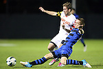 12 October 2012: Maryland's Jereme Raley (12) and Duke's Ryan Thompson (in blue). The University of Maryland Terrapins defeated the Duke University Blue Devils 2-1 at Koskinen Stadium in Durham, North Carolina in a 2012 NCAA Division I Men's Soccer game.