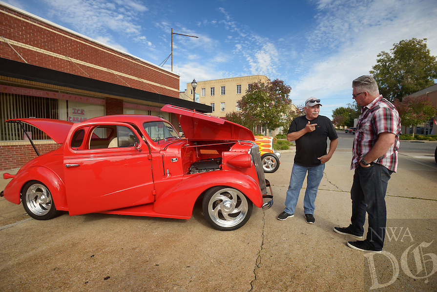 NWA Democrat-Gazette/BEN GOFF @NWABENGOFF<br /> Burley Gayer (left) of Little Flock, owner of the '37 Chevrolet coup street rod at left, talks with Monroe Hill of Prairie Grove, who was showing his Fox body Ford Mustang (not pictured) on Sunday Oct. 10, 2016 during The Circuit - A Charity with Horsepower monthly cruise night in downtown Rogers. The car show is usualy held on the second Saturday of each month in downtown Rogers, but was moved to sunday afternoon this month so car enthusiasts could also attend the Nash Back At Ya Car Club's 10th annual Monster's Ball on Saturday evening in Rogers.