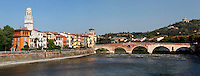 Panoramic view of Il Ponte Pietra, 100 BC, over the Adige River with the bell tower of the Cathedral (Duomo) on the left, Verona, Italy. The Via Postumia from Genua to the Brenner Pass crossed the Roman Ponte Pietra, or 'Stone Bridge', once known as the Pons Marmoreus. Its right hand arch was rebuilt in 1298 by Alberto I della Scala, and during the 2nd World War retreating German troops blew up 4 arches of the bridge,  which were rebuilt using original materials in 1957. Picture by Manuel Cohen.