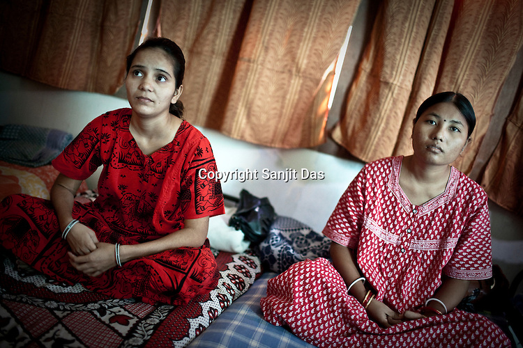Pregnant as a surrogate mother for first time, 20 year old Vaishali Sanket (left) is seen with another surrogate mother in Rabina's house in Anand, Gujarat, India. Rabina now mentors surrogate mothers and houses women throughout theior pregnancy.