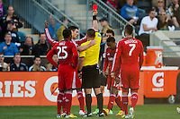 Referee Sorin Stoica red cards Ashtone Morgan (5) of Toronto FC. Toronto FC and the Philadelphia Union played to a 1-1 tie during a Major League Soccer (MLS) match at PPL Park in Chester, PA, on April13, 2013.
