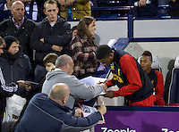 WEST BROMWICH, ENGLAND - Wednesday, September 26, 2012: Liverpool's 16-year-old Jerome Sinclair signs autographs on the bench against West Bromwich Albion during the Football League Cup 3rd Round match at the Hawthorns. (Pic by David Rawcliffe/Propaganda)