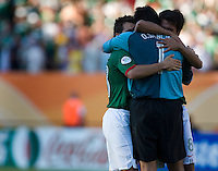 Mexican goalkeeper Oswald Sanchez receives hugs from his teammates after their match against Iran. Mexico defeated Iran 3-1 during a World Cup Group D match at Franken-Stadion, Nuremberg, Germany on Sunday June 11, 2006. Sanchez played only days after the death of his father in Mexico.