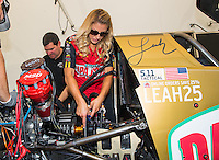 Sep 23, 2016; Madison, IL, USA; NHRA driver Leah Pritchett, pilot of the Papa Johns Pizza sponsored top fuel dragster of Don Schumacher Racing works on her car in the pits during qualifying for the Midwest Nationals at Gateway Motorsports Park. Mandatory Credit: Mark J. Rebilas-USA TODAY Sports