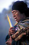 A K'iche' Maya woman priestess leads an indigenous spiritual ceremony near San Andres Xecul, Guatemala.