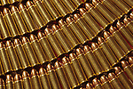 Winchester rifle cartridges, 38 special, full metal jacket, rows of bullets, patterns, warm light.