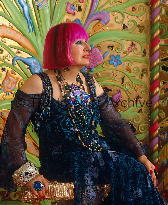 Portrait of Zandra Rhodes with flamboyant jewellery and trademark pink hair