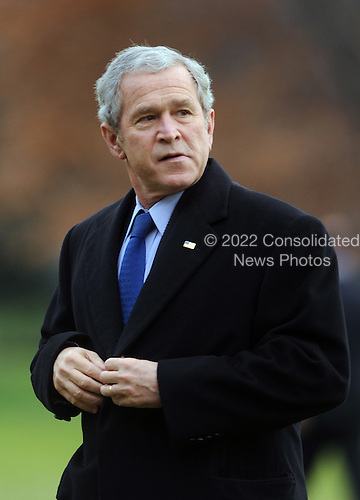 Washington, DC - December 17, 2008 -- United States President George W. Bush walks across the South Lawn of the White House after arriving in Washington on December 17, 2008. President Bush visited the U.S. Army War College in Carlisle, Pennsylvania..Credit: Alexis C. Glenn - Pool via CNP