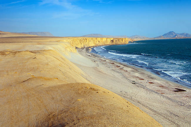 Vehicle rides along Playa Supay in the Paracas National Reserve in Peru, a subtropical coastal desert where sand and ocean come together.