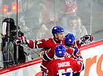 6 February 2010: Montreal Canadiens' center Tomas Plekanec (14) celebrates his goal with teammates, opening the scoring on the Pittsburgh Penguins with only 29 seconds into play at the Bell Centre in Montreal, Quebec, Canada. The Canadiens defeated the Penguins 5-3. Mandatory Credit: Ed Wolfstein Photo
