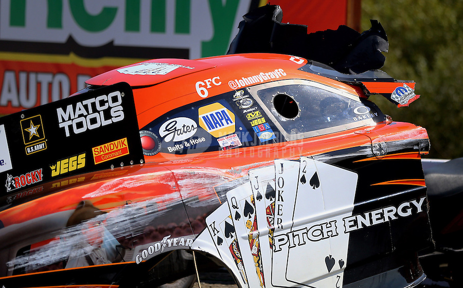 Jul. 28, 2013; Sonoma, CA, USA: Detailed view of the damaged remains to the body from the car of NHRA funny car driver Johnny Gray after an explosion during the Sonoma Nationals at Sonoma Raceway. Gray was uninjured. Mandatory Credit: Mark J. Rebilas-