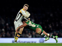 Elliot Daly of Wasps is tackled by Ofisa Treviranus of London Irish. Aviva Premiership match, between London Irish and Wasps on November 28, 2015 at Twickenham Stadium in London, England. Photo by: Patrick Khachfe / JMP