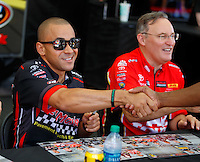 Jul 9, 2016; Joliet, IL, USA; NHRA top fuel driver J.R. Todd (left) and teammate Doug Kalitta during qualifying for the Route 66 Nationals at Route 66 Raceway. Mandatory Credit: Mark J. Rebilas-USA TODAY Sports