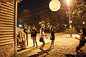 September 10, 2011. Raleigh, NC. . Playing with a Flaming Lips balloon in back of Lump Gallery.. The Hopscotch Music Festival took place from Sept. 8- Sept. 10 in downtown Raleigh, with over 100 bands playing various venues throughout the city.