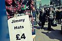 "Edinburgh, UK. 15.04.2017. People walk past a shop selling ""Jimmy Hats"" on Princes Street. Photograph © Jane Hobson."