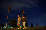 A couple walks outside admiring glowing hot air balloong outside of the Sun City Country Club in honor of the 50th anniversary of Sun City December 9, 2010...2010 marks the 50th anniversary of Sun City, America's first retirement city that remains the largest today with more than 40,000 residents 55 and older.
