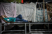 In this Thursday, Aug. 08, 2013 photo, a paramedic takes a nap at the field hospital of the sit-in at Al-Raba'a Alawya in the Nasr district of Cairo. (Photo/Narciso Contreras).
